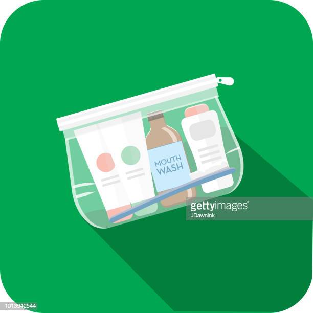 travel and tourism plastic toiletrie travel bag flat design themed icon set with shadow - toiletries stock illustrations