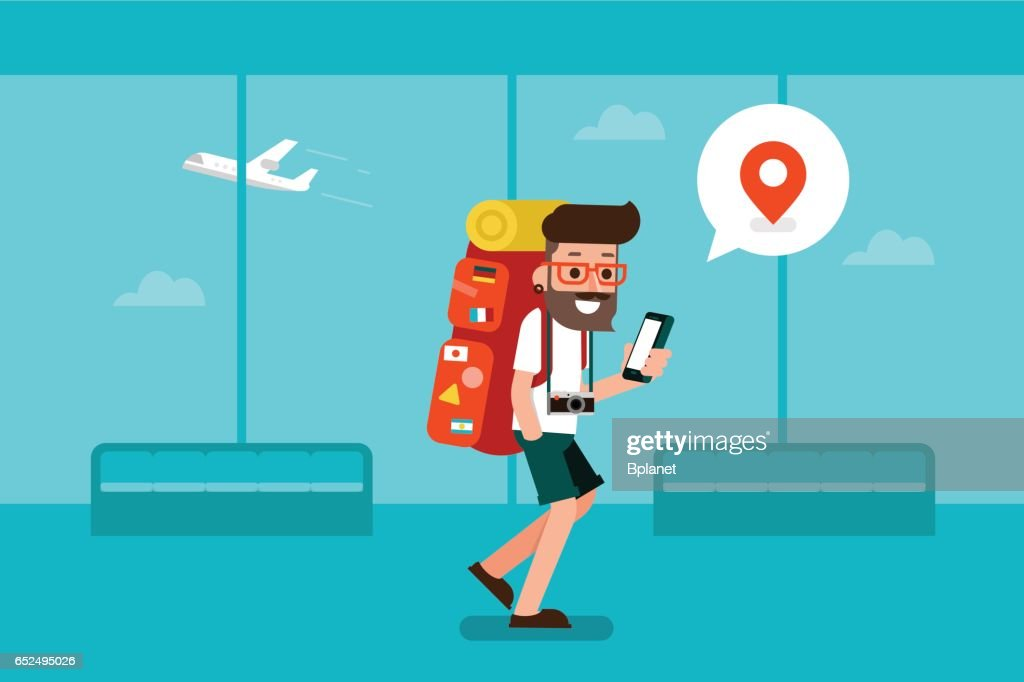 Traveler man using mobile phone in airport.