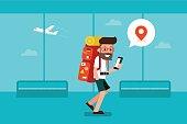 Traveler man using mobile phone in airport.