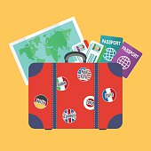 Traveler's suitcase, earth map, passports