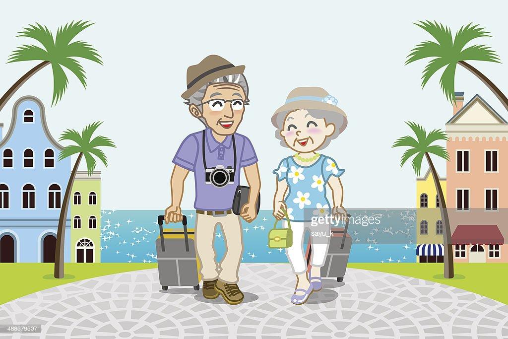 Traveling Senior Couple in Seaside town -EPS10