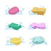 Trendy cartoon style bath and health care set. Different colors soaps and spoonges with bubbles.
