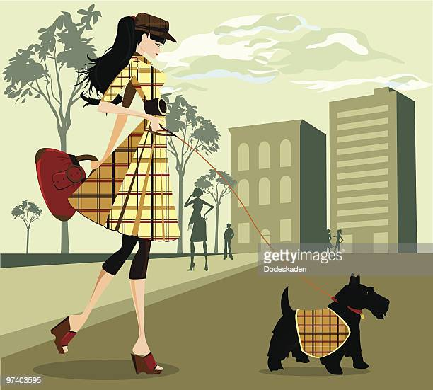 Trendy Young Woman Walking Her Dog Through City