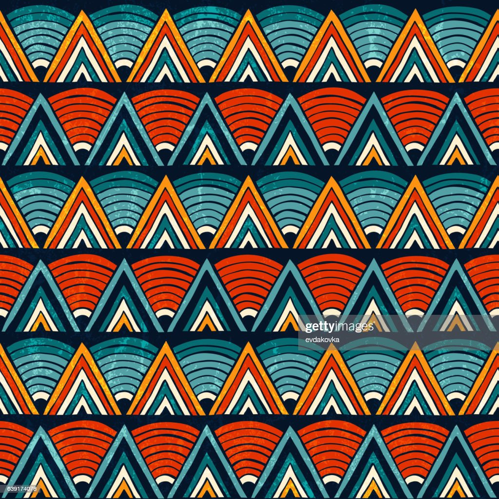 Tribal ornament in vibrant colours. Seamless abstract vector background.