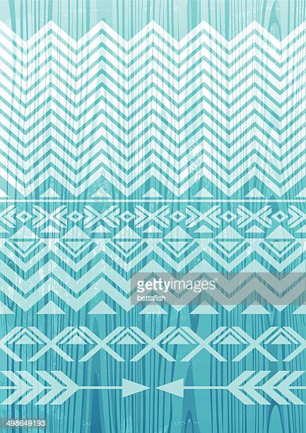 Tribal pattern on wooden background