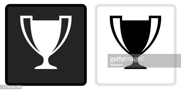 trophy icon on  black button with white rollover - trophy stock illustrations