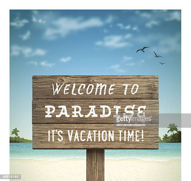 Tropical Beach with Wooden Sign