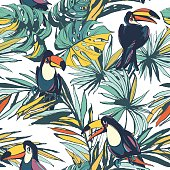 Tropical floral summer seamless pattern with palm leaves and toucans
