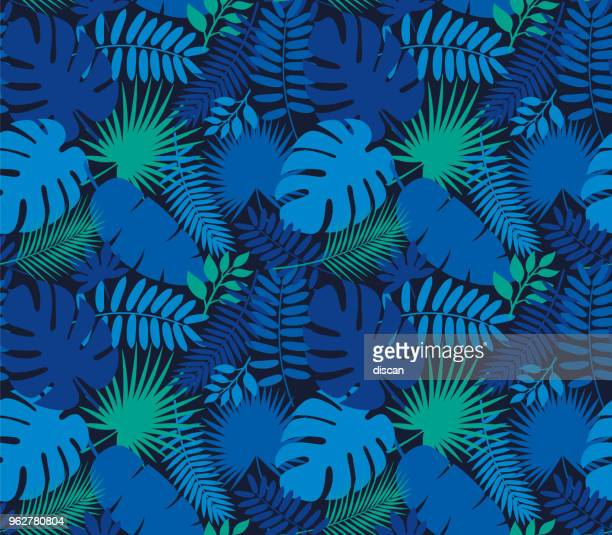 illustrazioni stock, clip art, cartoni animati e icone di tendenza di tropical leaf seamless pattern in dark indigo blue - motivo floreale