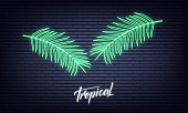 Tropical neon palm leaves. Glowing sign of coconut palm exotic leaves