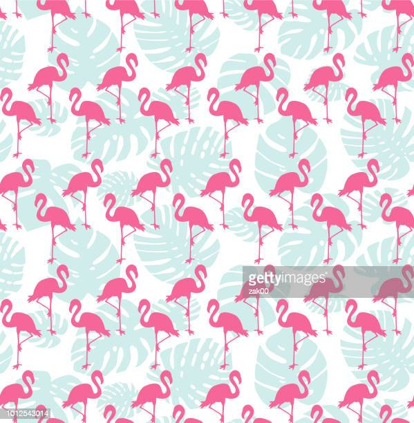 tropical seamless pattern with flamingos and mint green palm leaves - flamingo stock illustrations, clip art, cartoons, & icons