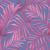 Tropical seamless pattern with pink palm leaves on purple background.