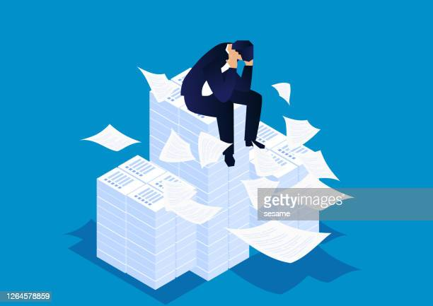 troubled businessman sitting on a large pile of documents, under heavy and hard work pressure - overworked stock illustrations