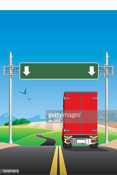 Truck on the road with road signs