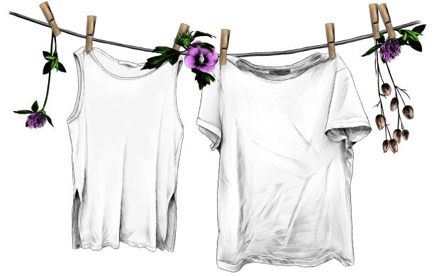 t-shirt and sleeveless t-shirt hanging on linen rope on wooden clothespins, rope decorated with flowers and leaves of clover and hibiscus
