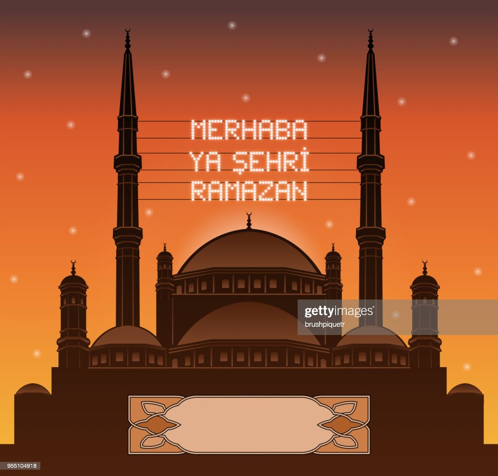 Turkish ramadan mahya lights over a mosque silhouette in front of sunset