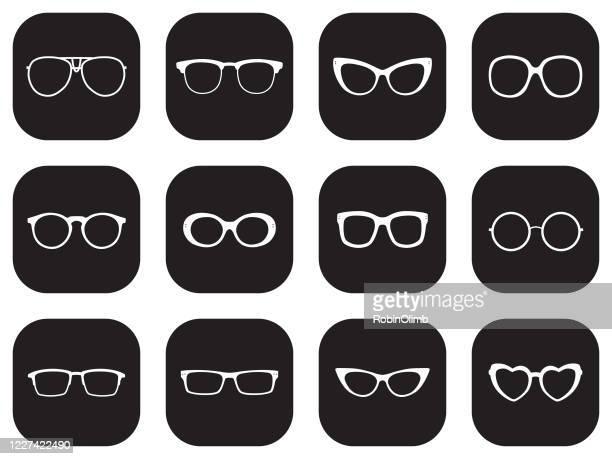twelve black eyeglasses icons - cat's eye glasses stock illustrations
