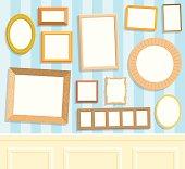 Twelve blank frames on a wall