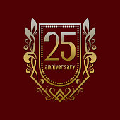 Twenty fifth anniversary vintage symbol. Golden emblem with numbers on shield in wreath.