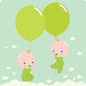 Twin babies with balloons