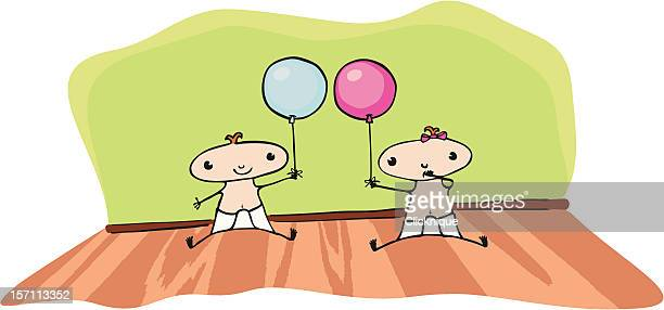 Twins with balloons