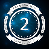 Two 2 Years Anniversary Celebration Design. Silver ring and ribbon on blue background. Colorful Vector template elements for your birthday party