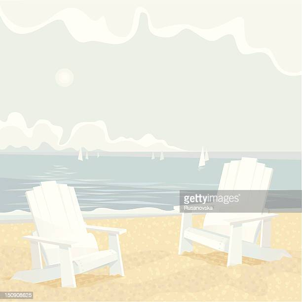 Two Adirondack Chairs on a Shore