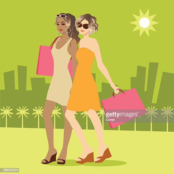Two Attractive Women Shopping Outdoors in Summer