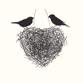 two birds making heir nest
