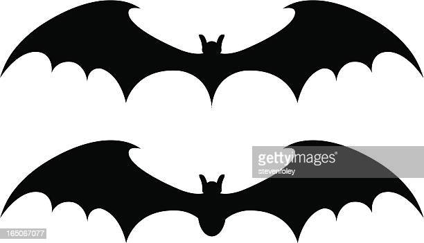 Two black bat designs on a white background