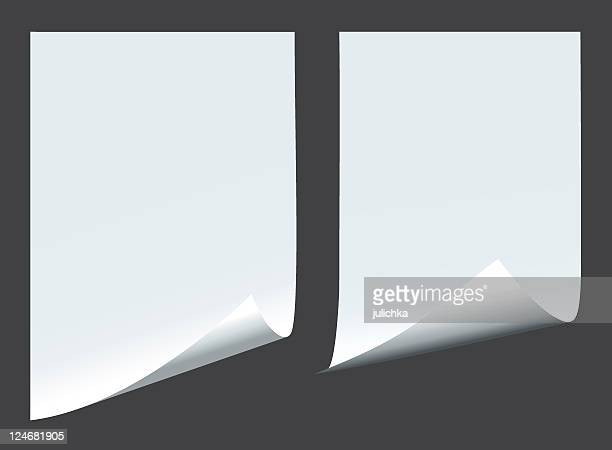 two blank pieces of paper on a dark background - curled up stock illustrations