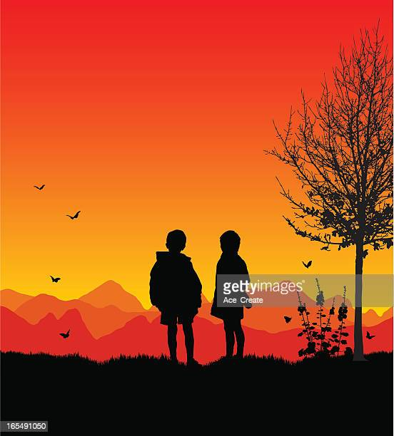 Two boys at sunset as friends of nature