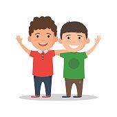 Two boys smile and hug