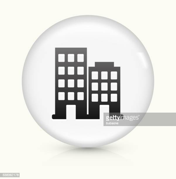 Two Buildings icon on white round vector button