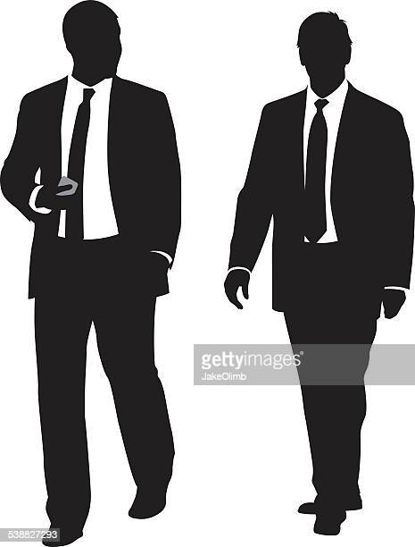 Two Business Men Walking and Talking Silhouette