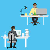 Two Businessman or office worker  sitting at a desk and working