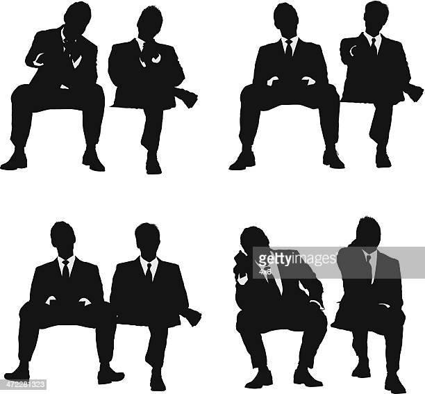 illustrations, cliparts, dessins animés et icônes de deux hommes d'affaires assis - assis