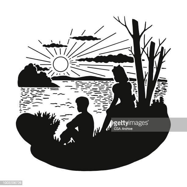 two children sitting on lakeshore - lakeshore stock illustrations