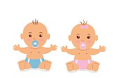Two cute baby in diapers with a pacifier