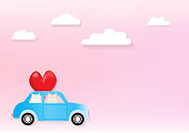 Two cute cats in a car with pink background