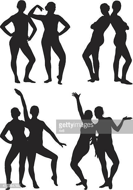 two female dancers in spandex posing together - back to back stock illustrations, clip art, cartoons, & icons