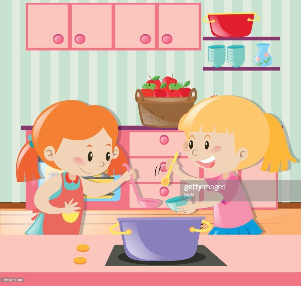 Zwei Mädchen Die Suppe In Der Küche Vektorgrafik | Getty Images