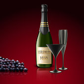Two glasses of champagne with bottle and grapes