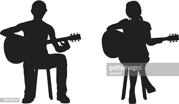two guitarists - plucking an instrument stock illustrations