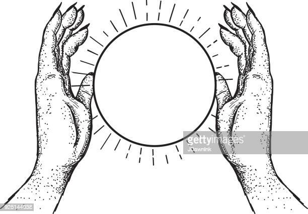 Two hands holding a crystal ball