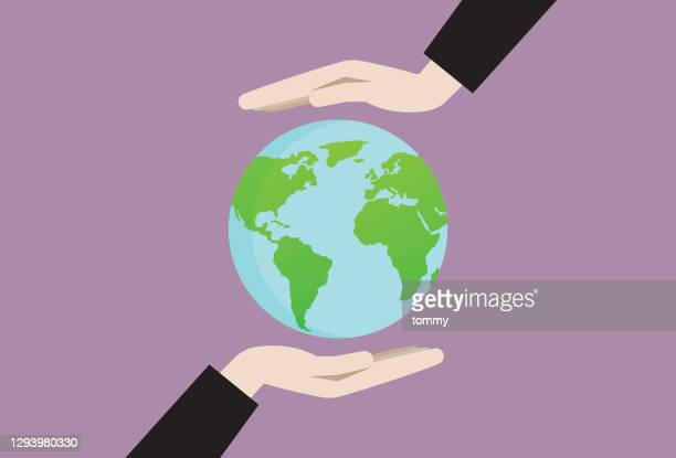 two hands holding an earth symbol - planet earth stock illustrations
