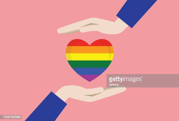 two hands with a rainbow heart - homosexual couple stock illustrations