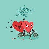Two happy hearts in love biking