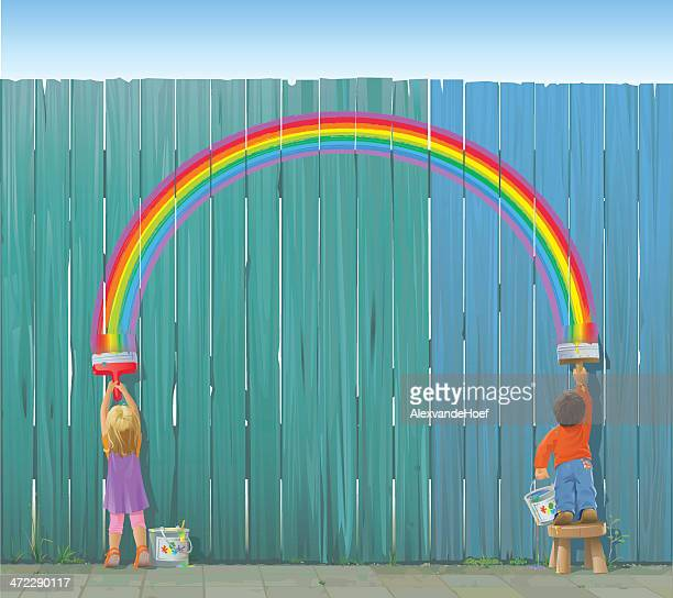 Two Kids Painting a Rainbow on Fence