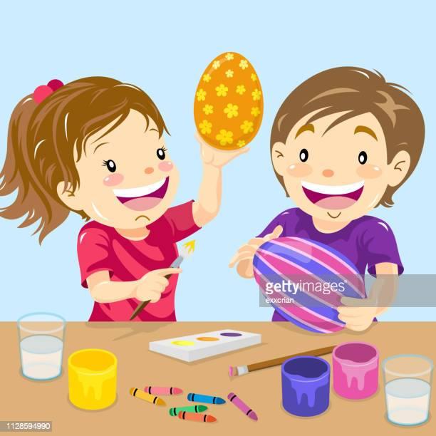 ilustraciones, imágenes clip art, dibujos animados e iconos de stock de dos niños huevos de pascua pintura - decorar